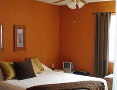 you will smile until you realize you had to sell or stage a house just like this paint colors accent walls and burnt orange bedroom