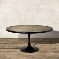 """Kenton 54"""" Table  Wood Top in solid reclaimed pine with hand-applied gray finish with lacquered finish (subtle sheen). Base and perimeter of tabletop are forged from heavy, solid iron w rivet detailing."""