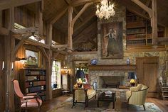 two storey library - hand-pegged timber frame - stone fireplace - Eberle Builders Inc.