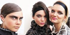 """Boys and girls"" was the theme backstage at Chanel and hair legend Sam McKnight worked his magic on models including Cara Delevingne, Kendall Jenner and Lily Donaldson accessorising undone French twists with black hair ribbons on the 'girls' and slick ponytails with faux sideburns on the 'boys'.   - Cosmopolitan.co.uk"