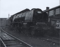 Coronation class 4-6-2  46240 'City of Coventry' at Camden shed London in the summer of 63.