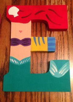 """Princess Ariel from The Little Mermaid """"E"""" Disney letter art. Mountable wooden letter. Customize your character and letter when you order on etsy! Shop DisneyByTheLetter!"""