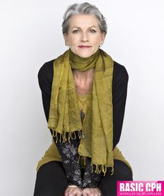 Nina short gray hair, gold scarf. Wouldn't have thought this was a good color for gray hair, but she looks great.