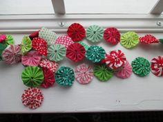 Yo-Yo Christmas Ornaments-took the little class at Quilting Adventures and these are so easy!!! Very motivated to try this and the other yo-yo's