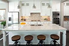 Dazzling White Granite Countertops look Minneapolis Traditional Kitchen Image Ideas with bar stools beige walls center island dark wood floors double oven kitchen kitchen tile