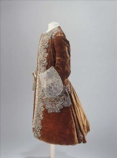 Side view, coat, c. 1730. Brown silk velvet with metallic thread embroidery.