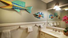 Key West house rental - The en-suite bathroom has separate vanities, original art and custom shower. Key West House Rentals, New Smyrna Beach, Beach Bathrooms, Custom Shower, Towel Holder, House 2, Guest Bath, Bathroom Storage, Home Decor Inspiration