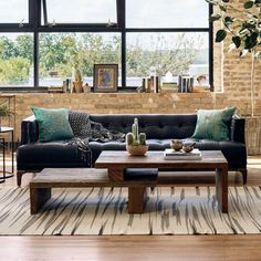 """The clever interplay of thick peroba wood slabs creates a modern take on the modular coffee table. Simple proportions and cunning shapes allow expansion from 48"""" to 76"""" wide. 42.25""""W x 28""""D x 16.25""""H"""