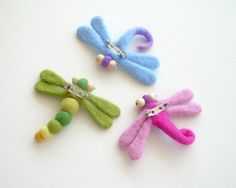 dragonfly brooches... love the one with the felted bead body