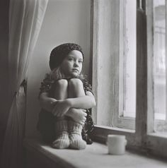 Sweet little girl lost in thought