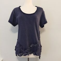 Free People Tee with Crochet Lace Bottom This beautiful Free People tee is in like new condition. Perfectly comfy and casual with unique lace detailing! No holes, stains or imperfections. // Comes from a smoke free environment. Bundles welcome Offers welcome ❌NO trades, please. ⚡️Same/Next day shipping Free People Tops Tees - Short Sleeve