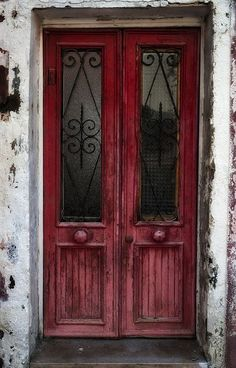 Fantastic deep red doors against gray house, Venice, Italy