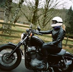 Morgan Gilman Garritson riding a Harley Nightster sporting a...