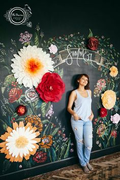 Chalkboard wall with giant paper flowers