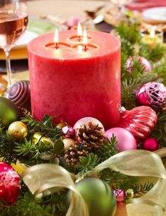 Take advantage of holiday scents by making a fragrant red candle the center of your next Christmas centerpiece. More Christmas centerpieces: http://www.midwestliving.com/homes/seasonal-decorating/easy-christmas-centerpiece-ideas/?page=9