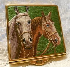 Hey, I found this really awesome Etsy listing at http://www.etsy.com/listing/160740335/vintage-embroidered-gold-tone-compact