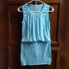 Light Blue Dress NWOT  Only tried on once and didn't fit. Has been hanging in closet since then. NWOT light blue dress. Boutique Dresses Mini