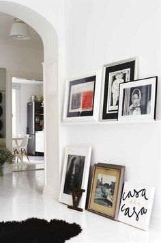 Picture frames on the floor.