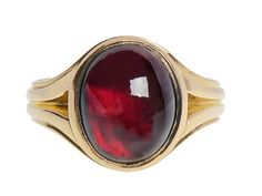 A Goblet of Wine -  English Garnet Ring. Here is one glorious Edwardian 18k yellow gold ring suitable for a woman or man. Tailored and strong, handsome and impressive, an oval cabochon garnet of 6.1 carats is foiled and set closed back in the manner often used back in the Georgian era.
