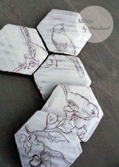 A lovely set of 5 hexagonal tiles featuring a bird design. Once put together will reveal a bird design. Terracotta with heavy white and clear glazes.The design has been scratched into the clay by myself and glazed. These would make a lovely gift, per.