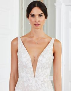 Every bride deserves to be the centre of attention on her big day! The Mandurah strapless mermaid wedding dress is covered with bold floral lace motifs that flow across the bodice into dramatic ruffles that add extra flair and fullness. Tiffany's Bridal, Mermaid Wedding, Floral Lace, Big Day, Ruffles, Flow, Centre, Bodice, Camisole Top