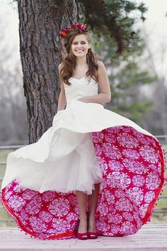 This looks like a traditional gown from far away— until you reveal the fun peekaboo layer!