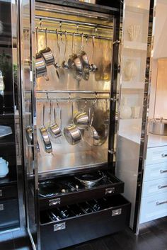 very cool metal cabinet for pots and pans