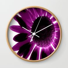 "Society6 ~ Daisy Divergence Wall Clocks #style #walldecor #popart #purple #homedecor #flowers #designs #shopping Available in natural wood, black or white frames, our 10"" diameter unique Wall Clocks feature a high-impact plexiglass crystal face and a backside hook for easy hanging. Choose black or white hands to match your wall clock frame and art design choice. Clock sits 1.75"" deep and requires 1 AA battery (not included)."