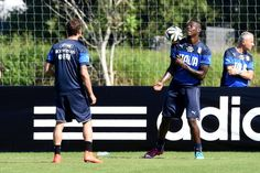 Mario Balotelli and Claudio Marchisio of Italy during a training...