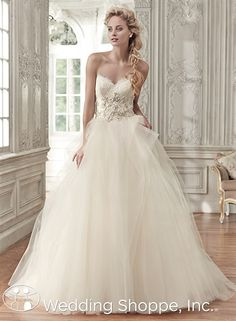 A romantic lace and tulle ball gown. | Maggie Sottero Bridal Gown Aracella