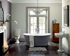 Vintage bathroom with fireplace and painted freestanding tub