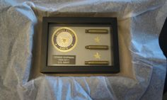 Remembering a Hero: Shadow box with shell casings from a 21-gun salute