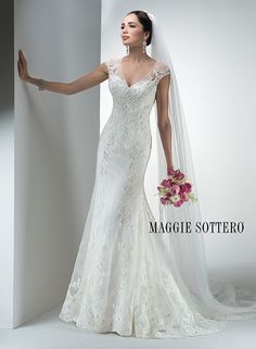 Stunning lace wedding dress with metallic threading, Fleur, by Maggie Sottero. Complete with illusion sweetheart neckline, backline and cap-sleeves.