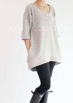 Le Pullover de Perri est lincarnation du style et de confort. La silhouette a-ligne couplé à la queue de poisson légère, à base dégagent son
