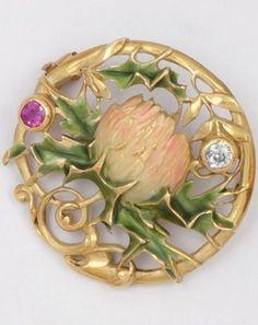 "ART NOUVEAU__""thistle"" brooch, circa 1900. Polychrome enamel, yellow gold, brilliant-cut diamonds and rubies."