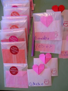 Valentines 2012: Graeme signed slips of paper that Dada folded into origami heart cards, and wrote classmates names onto pink label stickers. Glassine envelopes, stamp and stickers from The Paper Source (love that store!)