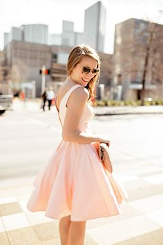 DRESS  pink flouncy cocktail dress(also available in black) |  SHOES  christian loubatin 'simple' pumps  |  SUNNIES  miu miu 52qs sunglasses  |  CLUTCH  oversized nude clutch(old, similar linked)  |  LIP COLOR  pink nouveau  |  EARRINGS  pearl…