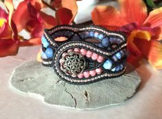 Infinity, Criss Cross Leather and Bead Bracelet,4 Rows, Pink and Blue fire Polished Beads, Unique