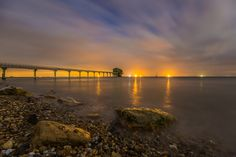 Lights of the station by Joe Linder            One of my favourite places to photograph on my home county of the Isle Of Wight. Bembridge lifeboat station, has many fantastic perspectives and the light is always different. Across the solent to the left of the image is an orange glow from Portsmouth, hanging in the clouds, from the centre to right are container ships, likely waiting in line to pull into Portsmouth or Southampton harbour. The station itself, sits high with 6 windows lit green…