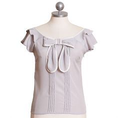 'topped with a bow' top from Ruche.