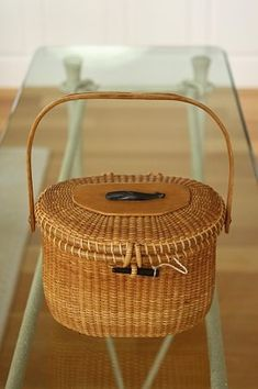 Nantucket Lightship Basket ( in detail with ebony whale ornament below left), a creel-style handbag, made by Jose Formoso Reyes in the Sewing Baskets, Old Baskets, Wicker Baskets, Bountiful Baskets, Nantucket Baskets, Weaving Art, Basket Weaving, Rattan, Whale