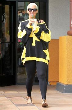 Amber Rose Photos Photos - Model Amber Rose stops for an iced coffee after getting a manicure in Studio City, California on September 4, 2014. Amber made headlines over the weekend when she posted a twerk video to celebrate her husband Wiz Khalifa's #1 album. - Amber Rose Stops For An Iced Coffee After Her Manicure
