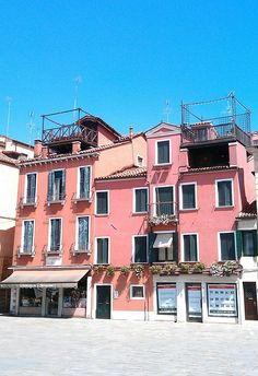 Roof terraces on one of Venice's many picturesque squares. Find inspiration for balcony sets and terrace furniture on our website: http://www.outandoutoriginal.com/garden-furniture/garden-balcony-sets