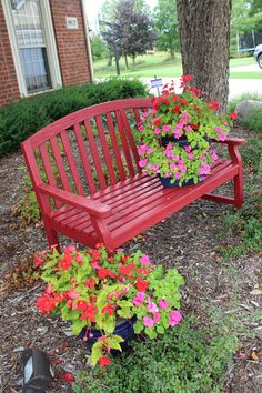 Love this red bench and red flowers. A beautiful display of pretty planters on this gorgeous bench.  Plan your flower containers now! Great planter idea.