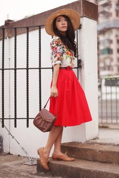 Red skirt, floral top