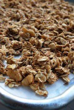 Clean Eating Granola (Makes approximately 3 1/2 cups) Ingredients:3 cups mixed grains (rolled oats will work fine as well)1/2 cup walnuts – chopped1/2 cup unsweetened applesauce 1/4 cup honey 2 teaspoons cinnamon Directions: Preheat oven to 325 degrees F. Put your grains and walnuts in a large mixing bowl.