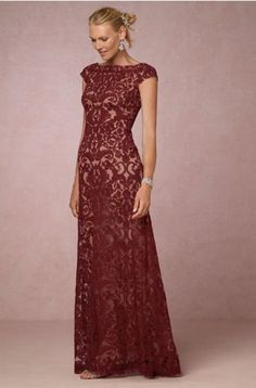 Deep reds are the color of fall, making this dress on-trend. The intricate embroidery overlays create an elegant design for a more formal ceremony. | Mother of the Bride Dresses for Fall Weddings