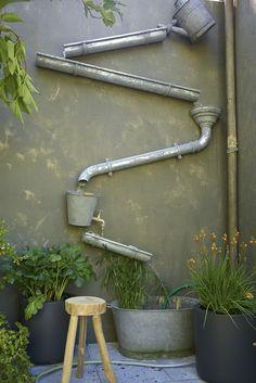 What a charming way to fill a blank wall in the garden! Could rely on the gutter for occasional water sound, or pipe it for continuous water flow...