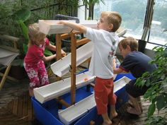 water play - rain gutters, plastic tub, wood, rotary hand pump