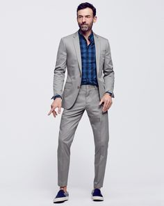 MAY '15 Style Guide: J.Crew men's Italian chino Ludlow suit, slim indigo cotton shirt in large gingham and Vans for J.Crew classic slip-on in two-tone denim.